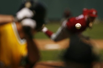 baseball-in-focus-pitcher-batter-blurred-out-of-focus.jpg